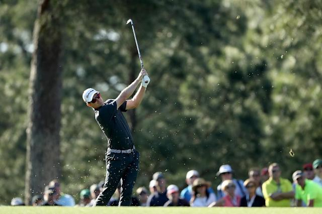 Justin Rose of England plays his second shot on the 14th hole during the final round of the 2017 Masters Tournament at Augusta National Golf Club on April 9, 2017 in Augusta, Georgia (AFP Photo/DAVID CANNON)