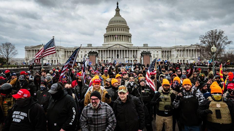 Pro-Trump protesters gather in front of the U.S. Capitol Building on Jan. 6, a mob that eventually stormed the Capitol, breaking windows and clashing with police officers, killing one. (Photo by Jon Cherry/Getty Images)