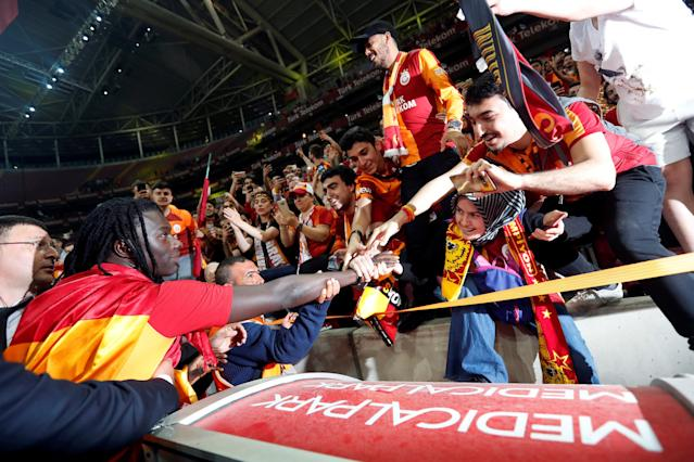 Soccer Football - Galatasaray Turkish Super League Trophy Presentation - Turk Telekom Arena, Istanbul, Turkey - May 20, 2018 Galatasaray's Bafetimbi Gomis with fans REUTERS/Murad Sezer