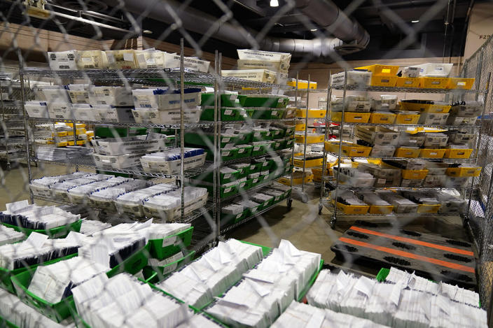 Ballots for the 2020 General Election in the United States are seen at Philadelphia's mail-in ballot sorting and counting center, Monday, Oct. 26, 2020, in Philadelphia. (AP Photos/Matt Slocum)