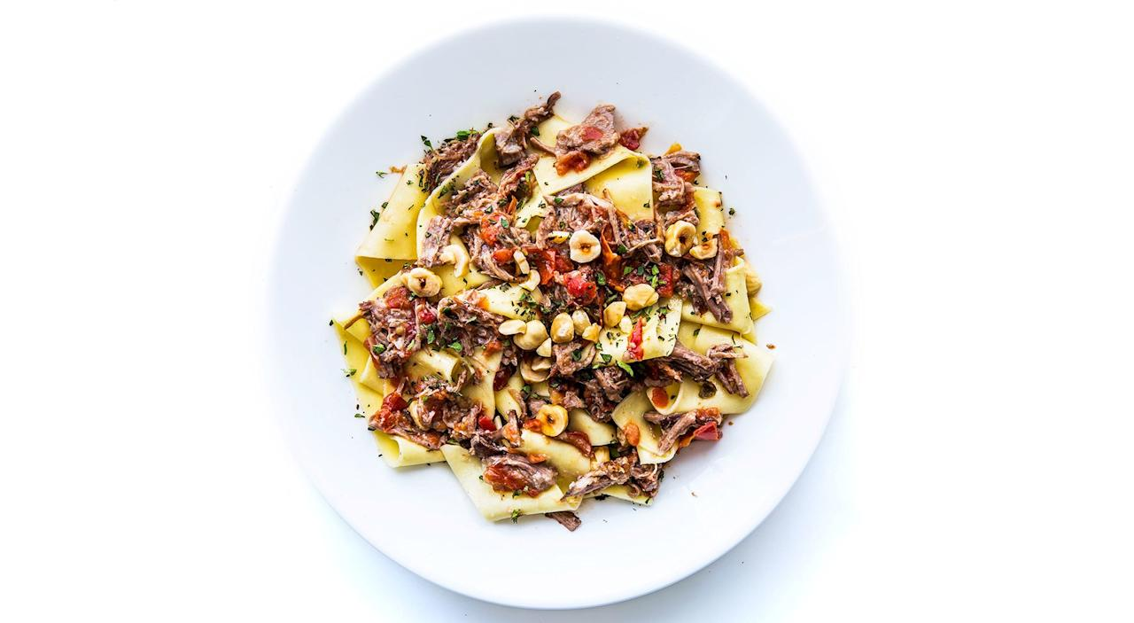 """This Sunday sauce yields twice what you'll need, but it freezes beautifully; bank the extra and cash it in on another night. <a href=""""https://www.bonappetit.com/recipe/pappardelle-with-pork-sugo-hazelnuts?mbid=synd_yahoo_rss"""">See recipe.</a>"""