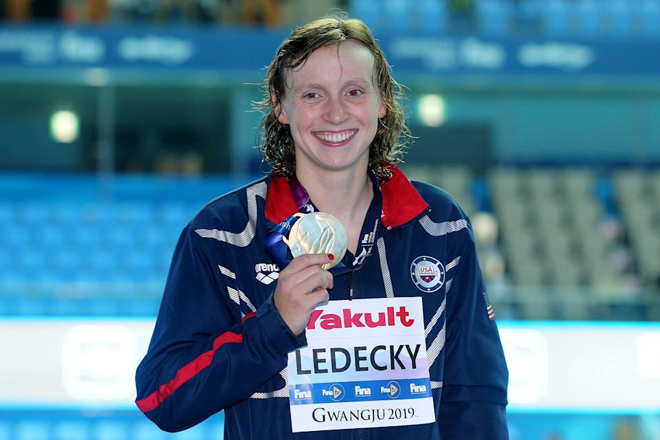 Olympic champion Katie Ledecky swims length of pool with glass of milk on her head