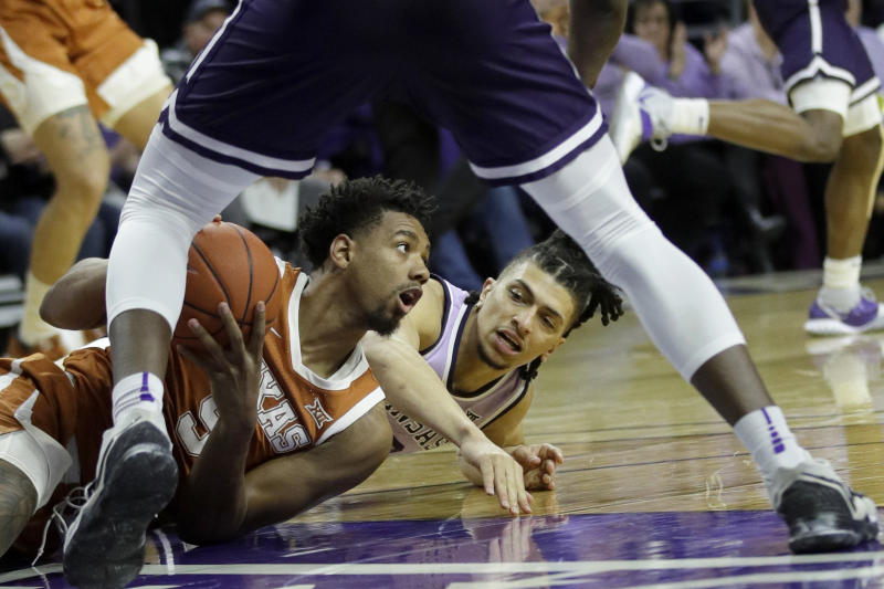 Texas forward Royce Hamm Jr., left, and Kansas State guard Mike McGuirl, right, go to the floor after a loose ball during the first half of an NCAA college basketball game in Manhattan, Kan., Saturday, Feb. 22, 2020. (AP Photo/Orlin Wagner)