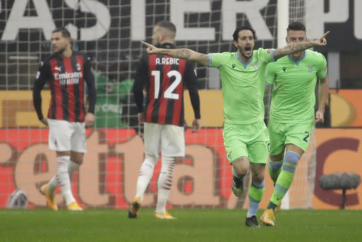 Lazio's Luis Alberto celebrates his goal against AC Milan during a Serie A soccer match between AC Milan and Lazio, at the San Siro stadium in Milan, Italy, Wednesday, Dec. 23, 2020. (AP Photo/Luca Bruno)