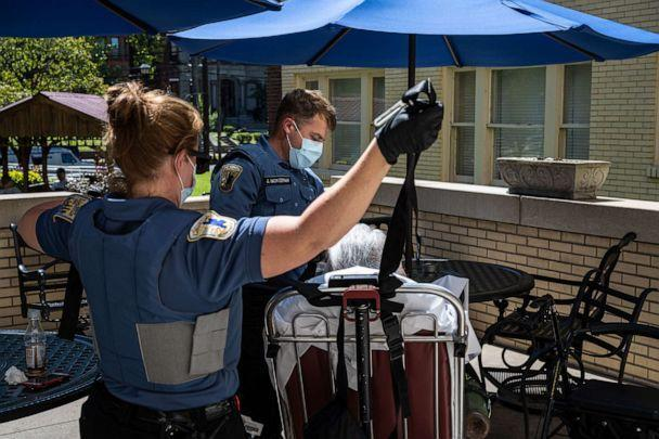 PHOTO: Louisville Metro EMS paramedics assist a woman suspected of experiencing a severe COVID-19 emergency onto a gurney in front of her apartment building, Sept. 6, 2021, in Louisville, Kentucky. (Jon Cherry/Getty Images)