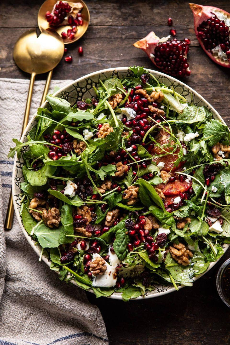 """<p>Arugula and mixed greens are topped with candied walnuts, blood orange pieces, and a generous amount of pomegranate arils. Your Thanksgiving diners will love it!</p><p><strong>Get the recipe at <a href=""""https://www.halfbakedharvest.com/winter-salad-maple-candied-walnuts-balsamic-fig-dressing-big-giveaway/"""" rel=""""nofollow noopener"""" target=""""_blank"""" data-ylk=""""slk:Half Baked Harvest"""" class=""""link rapid-noclick-resp"""">Half Baked Harvest</a>.</strong> </p>"""