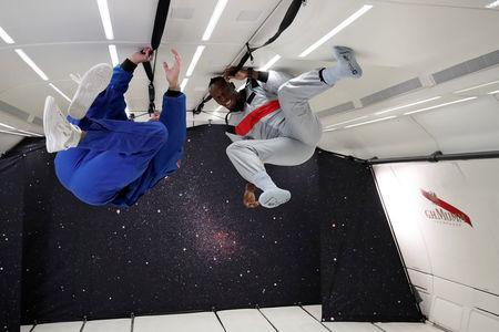 Retired sprinter Usain Bolt and French astronaut Jean-Francois Clervoy, CEO of Novespace, enjoy zero gravity conditions during a flight in a specially modified Airbus Zero-G plane above Reims, France, September 12, 2018. REUTERS/Benoit Tessier