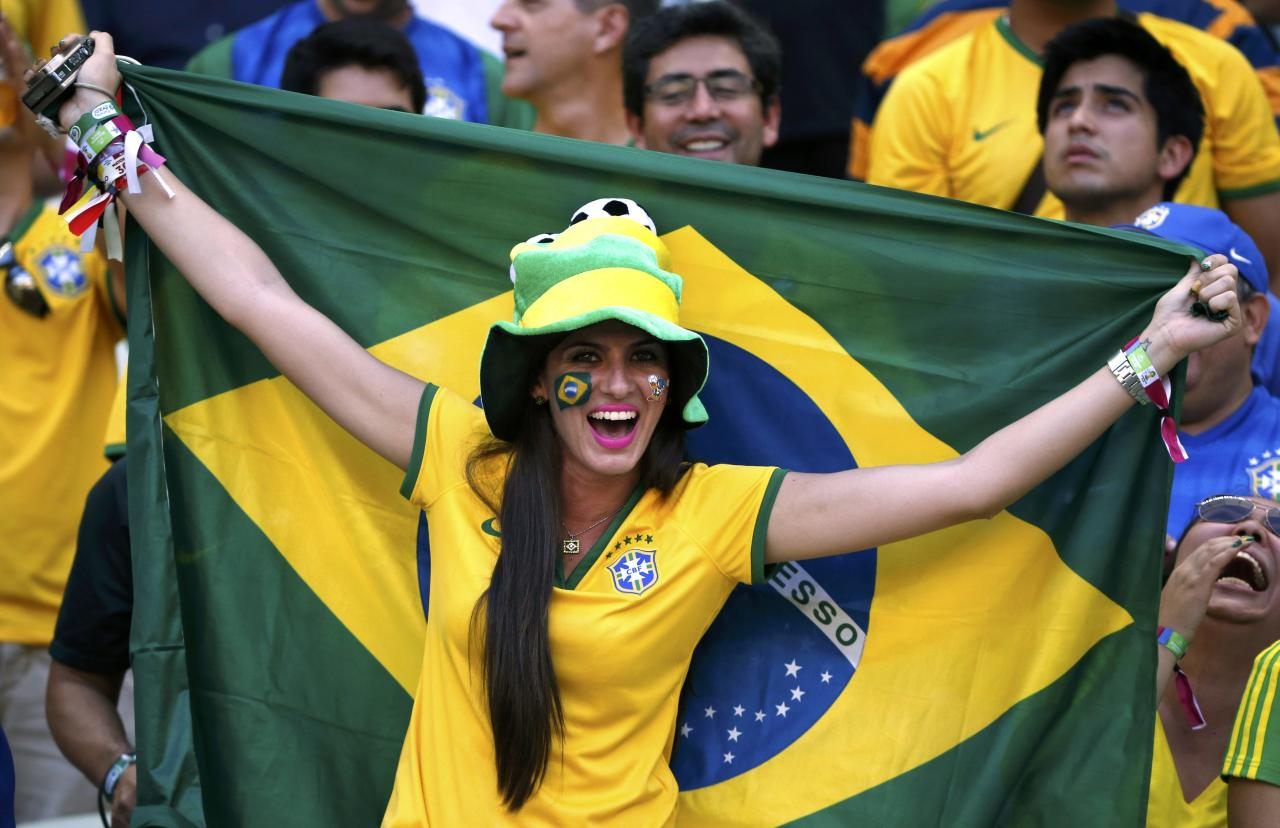 A Brazil fan cheers before the 2014 World Cup quarter-finals between Brazil and Colombia at the Castelao arena in Fortaleza July 4, 2014. REUTERS/Jorge Silva (BRAZIL - Tags: SOCCER SPORT WORLD CUP)