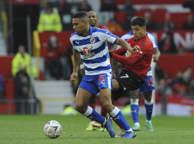 Reading's Callum Harriott, left, and Manchester United's Alexis Sanchez challenge for the ball during the English FA Cup third round soccer match between Manchester United and Reading at Old Trafford in Manchester, England, Saturday, Jan. 5, 2019. (AP Photo/Rui Vieira)