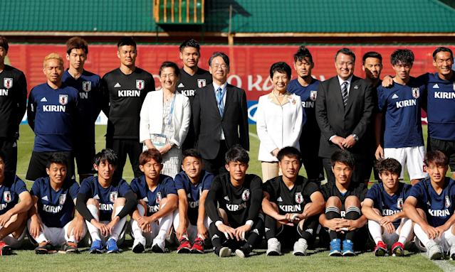 Soccer Football - World Cup - Japan Training - Japan Training Camp, Kazan, Russia - June 21, 2018 Japan's Princess Takamado poses for a picture with Japan's players and staff during training REUTERS/John Sibley