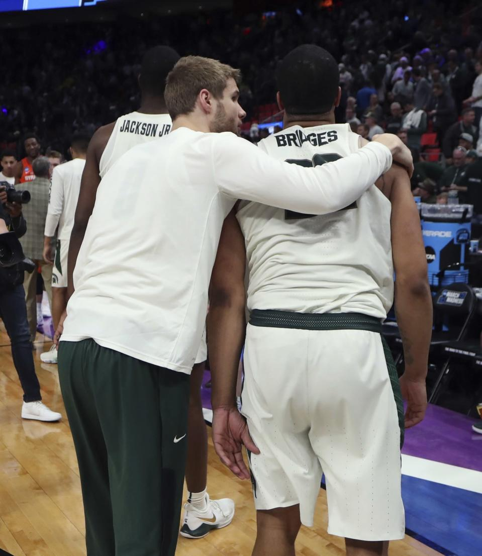 Michigan State guard Miles Bridges, right, is consoled after the team's 55-53 loss to Syracuse in a second round game in the NCAA college basketball tournament, Sunday, March 18, 2018, in Detroit. (AP Photo/Carlos Osorio)