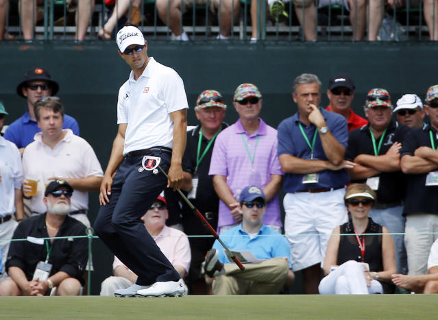 Adam Scott, of Australia, reacts to missing a putt on the first green during the fourth round of the Masters golf tournament Sunday, April 13, 2014, in Augusta, Ga. (AP Photo/David J. Phillip)