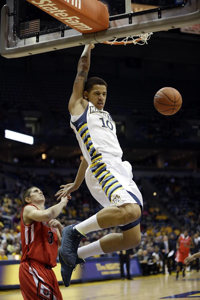 Marquette's Juan Anderson dunks in front of Ball State's Quinten Payne during the first half of an NCAA college basketball game Tuesday, Dec. 17, 2013, in Milwaukee. (AP Photo/Morry Gash)