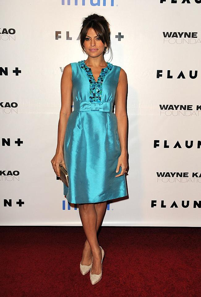 "Eva Mendes looked stunning as always upon arriving at Flaunt Magazine's 10th Anniversary Party and Annual Holiday Toy Drive. Jordan Strauss/<a href=""http://www.wireimage.com"" target=""new"">WireImage.com</a> - December 18, 2008"