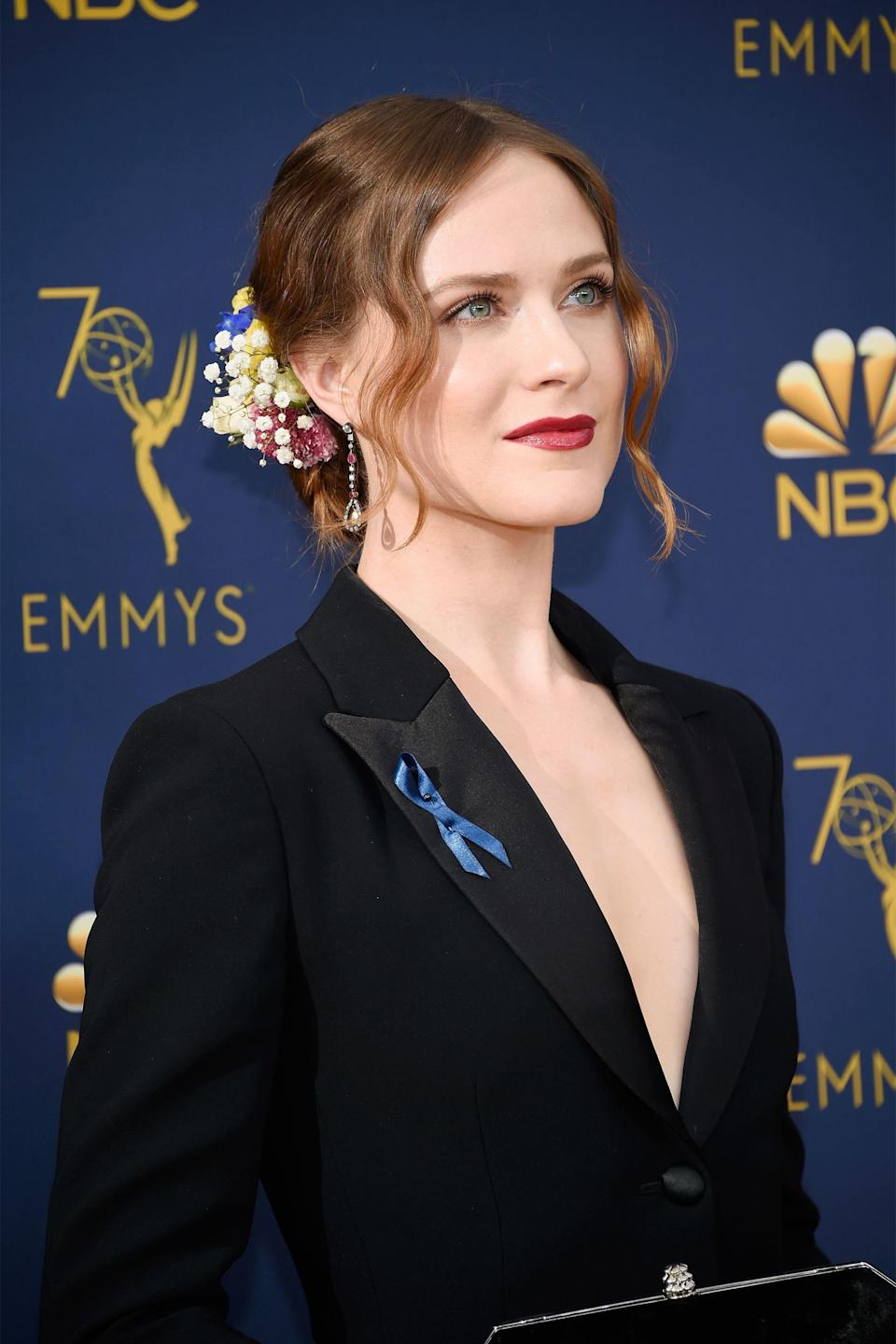 """<p>Evan Rachel Wood took a page out of <a href=""""https://www.refinery29.com/en-us/2018/09/209607/hair-accessories-from-nyfw#slide-8"""" rel=""""nofollow noopener"""" target=""""_blank"""" data-ylk=""""slk:Rodarte's NYFW show"""" class=""""link rapid-noclick-resp"""">Rodarte's NYFW show</a> with her floral-accented chignon, which was created by <a href=""""https://www.instagram.com/hairbyjohnd/"""" rel=""""nofollow noopener"""" target=""""_blank"""" data-ylk=""""slk:John D"""" class=""""link rapid-noclick-resp"""">John D</a> using ghd tools and fresh flowers.</p><span class=""""copyright"""">Photo: Kevin Mazur/Getty Images. </span>"""