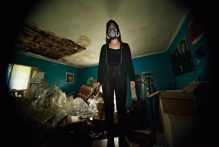 """Kyoko Takenaka stands in their crumbling childhood house in the short film """"Home."""""""