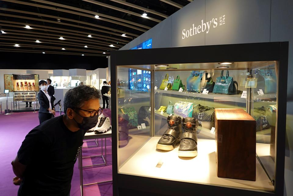 A visitor looks at a pair of