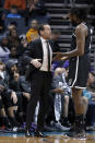 Brooklyn Nets coach Kenny Atkinson, left, talks with DeAndre Jordan during the first half of the team's NBA basketball game against the Charlotte Hornets in Charlotte, N.C., Friday, Dec. 6, 2019. (AP Photo/Bob Leverone)