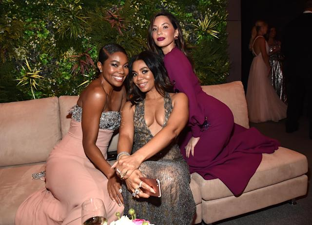 <p>Regina Hall may have been planning a girls' trip with her party pals Union and Munn at the <em>Vanity Fair</em> party. (Photo: Kevin Mazur/VF18/WireImage) </p>