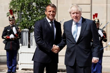 French President Emmanuel Macron welcomes British Prime Minister Boris Johnson before a meeting on Brexit at the Elysee Palace in Paris