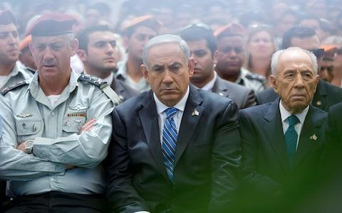 Mr Netanyahu (centre) and Mr Gantz (left) once worked closely together - Credit: Photo by Jim Hollander - Pool/Getty Images