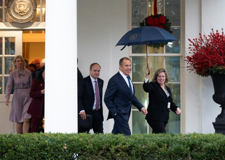Russian Foreign Minister Sergei Lavrov departs the White House after meeting with US President Donald Trump, an encounter that sparked anger from Democrats (AFP Photo/JIM WATSON)