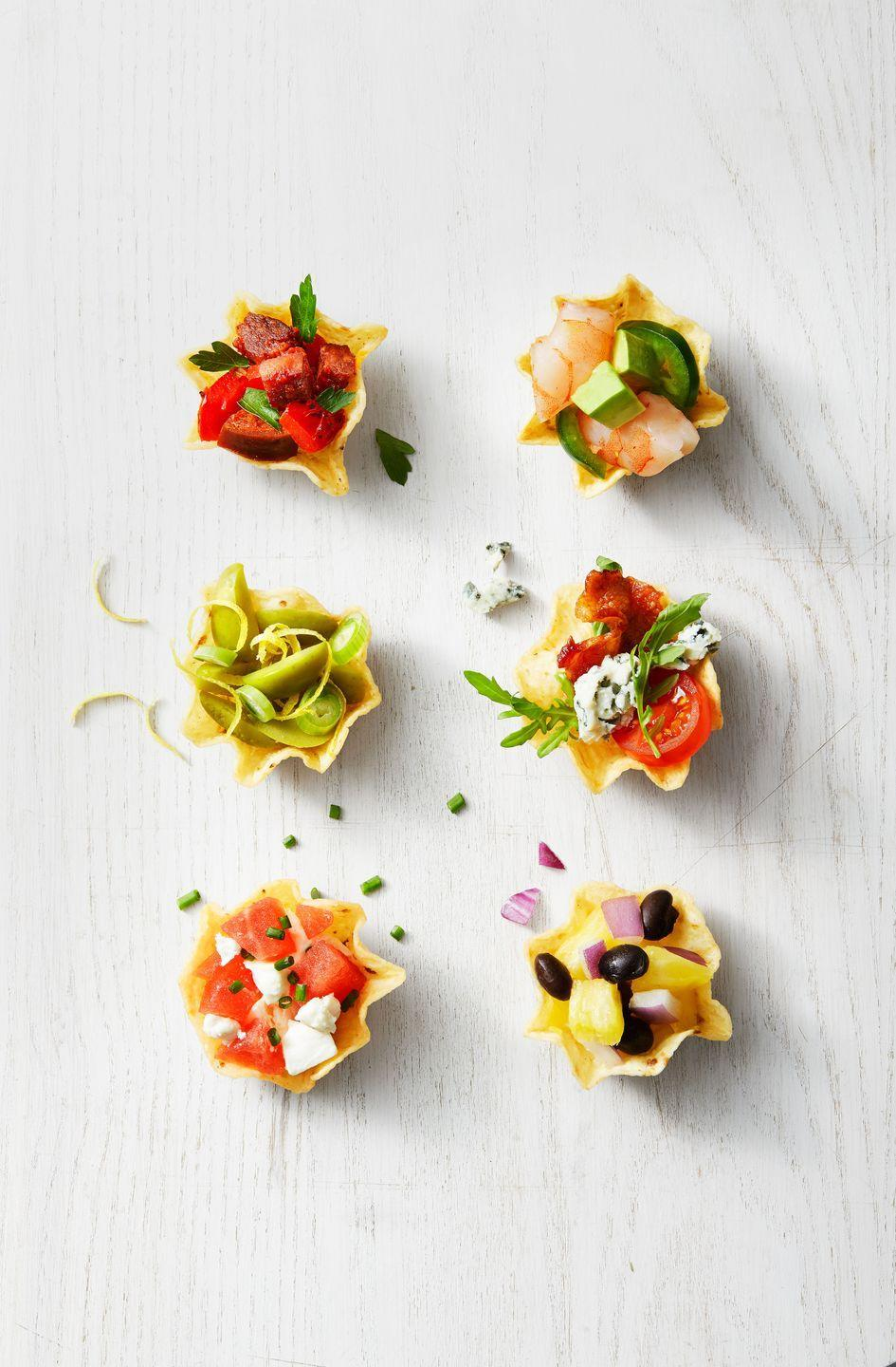 """<p>This no-bake snack features tons of topping combo ideas for tortilla chip cups. So easy.</p><p><em><a href=""""https://www.goodhousekeeping.com/food-recipes/a35191279/stuffed-tortilla-cups-recipe/"""" rel=""""nofollow noopener"""" target=""""_blank"""" data-ylk=""""slk:Get the recipe for Stuffed Tortilla Cups »"""" class=""""link rapid-noclick-resp"""">Get the recipe for Stuffed Tortilla Cups »</a></em></p>"""