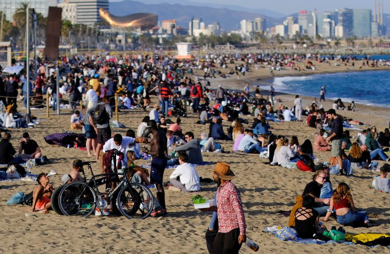 FILE PHOTO: People spend time at Barceloneta beach, in Barcelona