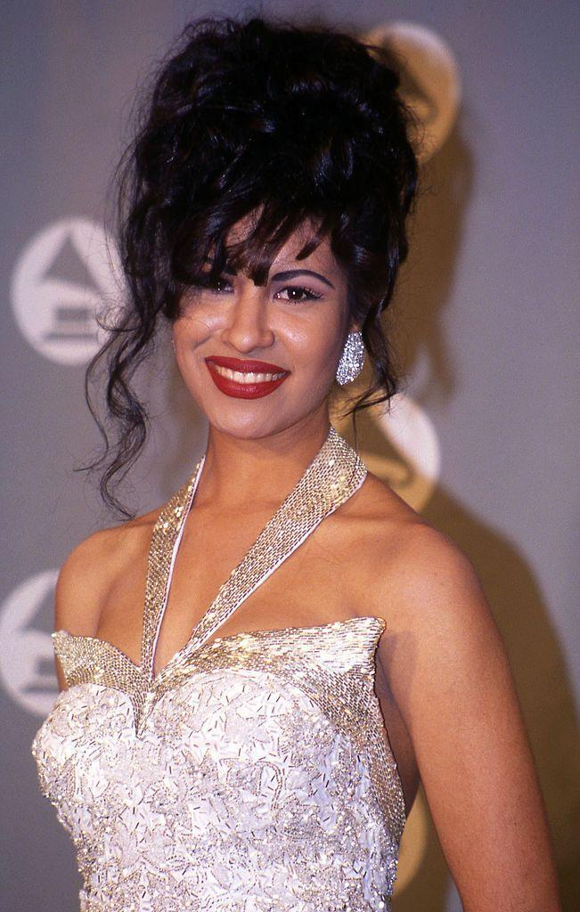 """<p>Decades after her unexpected death, <a href=""""https://www.goodhousekeeping.com/life/entertainment/g32743619/netflix-selena-the-series-cast/"""" rel=""""nofollow noopener"""" target=""""_blank"""" data-ylk=""""slk:Selena"""" class=""""link rapid-noclick-resp"""">Selena</a> continues to be an inspiration to fellow artists and longtime fans. The Tex-Mex singer lives in history with her bold fashion choices, lively dance moves, and powerful vocals. Selena's life story will be explored in the upcoming Netflix show <em><a href=""""https://www.goodhousekeeping.com/life/entertainment/a30860047/netflix-selena-the-series-start-date-cast-spoilers/"""" rel=""""nofollow noopener"""" target=""""_blank"""" data-ylk=""""slk:Selena: The Series"""" class=""""link rapid-noclick-resp"""">Selena: The Series</a></em> with the Quintanilla family working closely on it.</p>"""