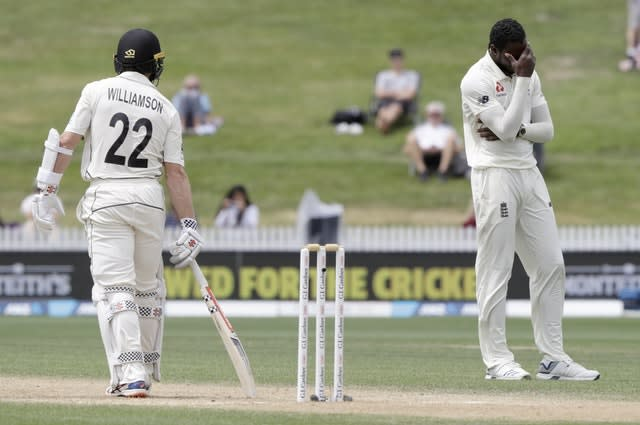 Joe Denly's drop of Kane Williamson left Jofra Archer, right, with his head in his hands (Mark Baker/AP)