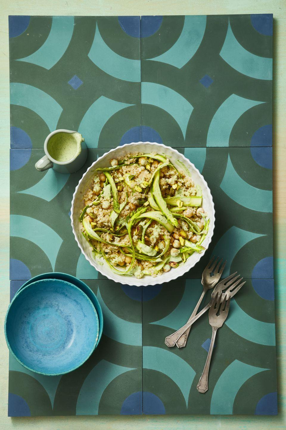 """<p>Shaved asparagus ribbons make this simple quinoa and chickpea salad more special. Plus, the hearty vegetable can stand up to creamy tahini dressing.</p><p><em><a href=""""https://www.goodhousekeeping.com/food-recipes/healthy/a19866004/tahini-lemon-quinoa-with-asparagus-ribbons-recipe/"""" rel=""""nofollow noopener"""" target=""""_blank"""" data-ylk=""""slk:Get the recipe for Tahini-Lemon Quinoa with Asparagus Ribbons »"""" class=""""link rapid-noclick-resp"""">Get the recipe for Tahini-Lemon Quinoa with Asparagus Ribbons »</a></em></p>"""