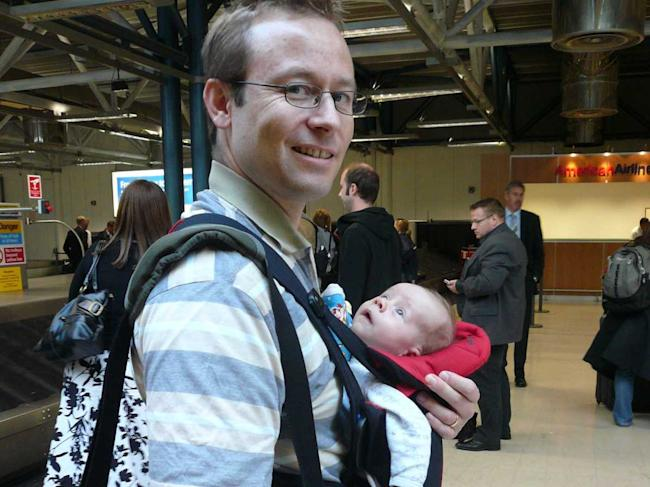 Man Wearing Baby In The Airport