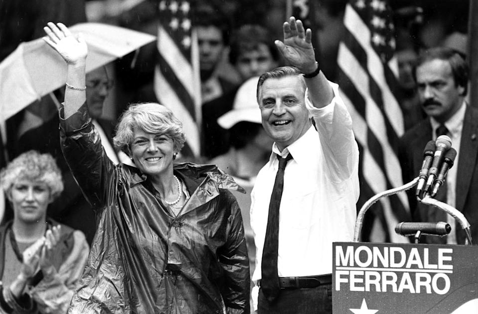 Democratic presidential candidate Walter Mondale and his running mate, Geraldine Ferraro, wave
