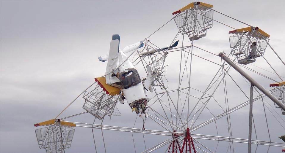 An ultra-light plane crashed and lodged in a ferris wheel