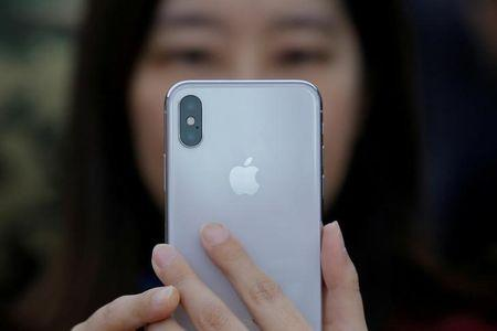 FILE PHOTO: A attendee uses a new iPhone X during a presentation for the media in Beijing