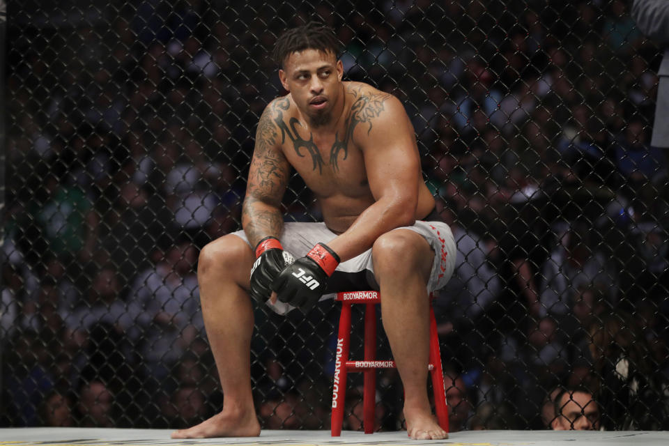 Greg Hardy sits during a break in a heavyweight mixed martial arts bout against Ben Sosoli, Friday, Oct. 18, 2019, at UFC Fight Night in Boston. (AP Photo/Elise Amendola)