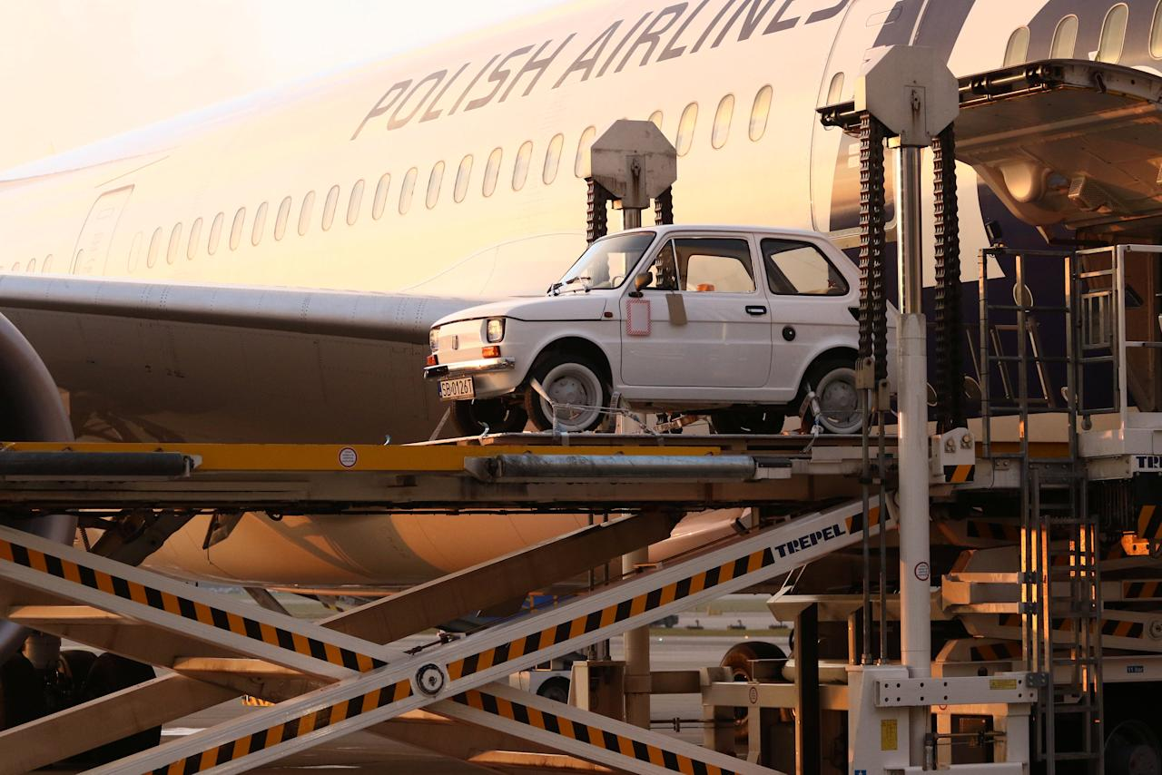 A Fiat 126p, which Polish fans have bought for U.S. actor Tom Hanks as a souvenir, is seen during loading on board of the LOT Polish Airlines Dreamliner to fly to Los Angeles in Warsaw, Poland November 27, 2017 Agencja Gazeta/Slawomir Kaminski via REUTERS ATTENTION EDITORS - THIS IMAGE WAS PROVIDED BY A THIRD PARTY. POLAND OUT. NO COMMERCIAL OR EDITORIAL SALES IN POLAND.