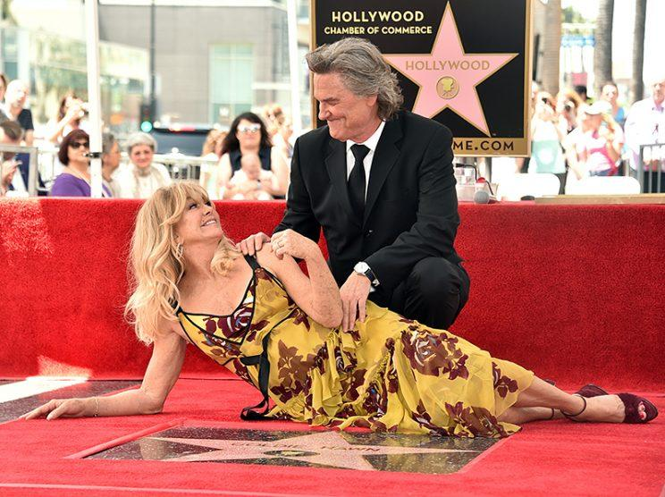 Goldie Hawn and Kurt Russell look at each other lovingly while being honored with stars on the Hollywood Walk of Fame.