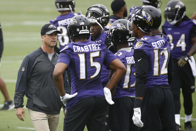 John Harbaugh and the Ravens have been fined for having contact in their OTA workouts. (AP Photo/Patrick Semansky)