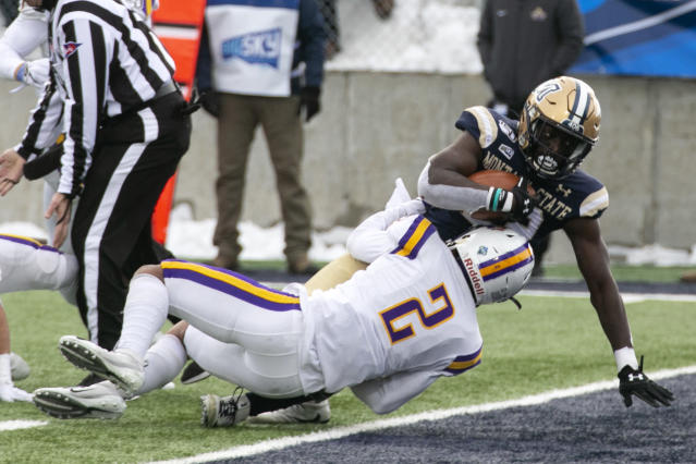 Montana State's Isaiah Ifanse plows over Albany's Tyler Carswell on his way to a first-half touchdown during a second-round game in the NCAA Football Championship Subdivision playoffs Saturday, Dec. 7, 2019, in Bozeman, Mont. (Ryan Berry/Bozeman Daily Chronicle via AP)