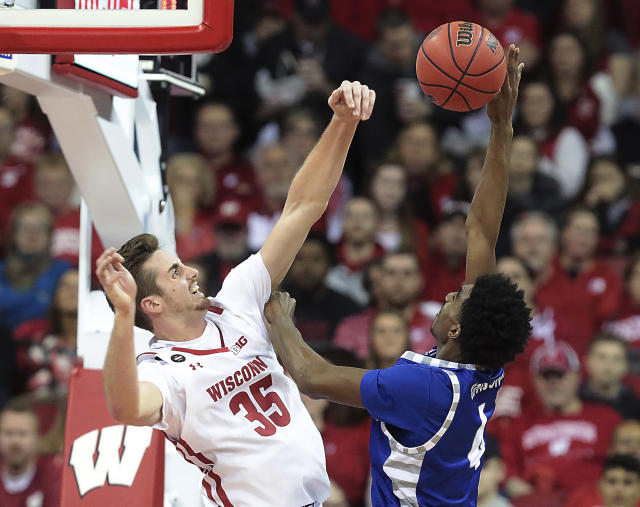 Wisconsin forward Nate Reuvers (35) blocks the shot of Eastern Illinois guard Marvin Johnson (4) during the first half of an NCAA college basketball game in Madison, Wis., Friday, Nov. 8, 2019. (John Hart/Wisconsin State Journal via AP)