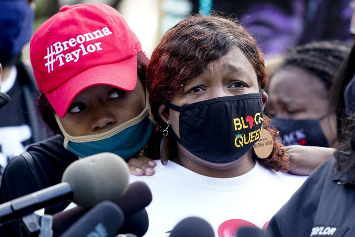 Tamika Palmer, right, the mother of Breonna Taylor, listens to a news conference in Louisville, Ky. (Darron Cummings/AP)