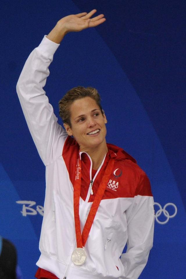 United States' Dara Torres celebrates winning the silver medal during the medal ceremony of the women's 50-meter freestyle final during the swimming competitions in the National Aquatics Center at the Beijing 2008 Olympics in Beijing, Sunday, Aug. 17, 2008. (AP Photo/Mark J. Terrill)