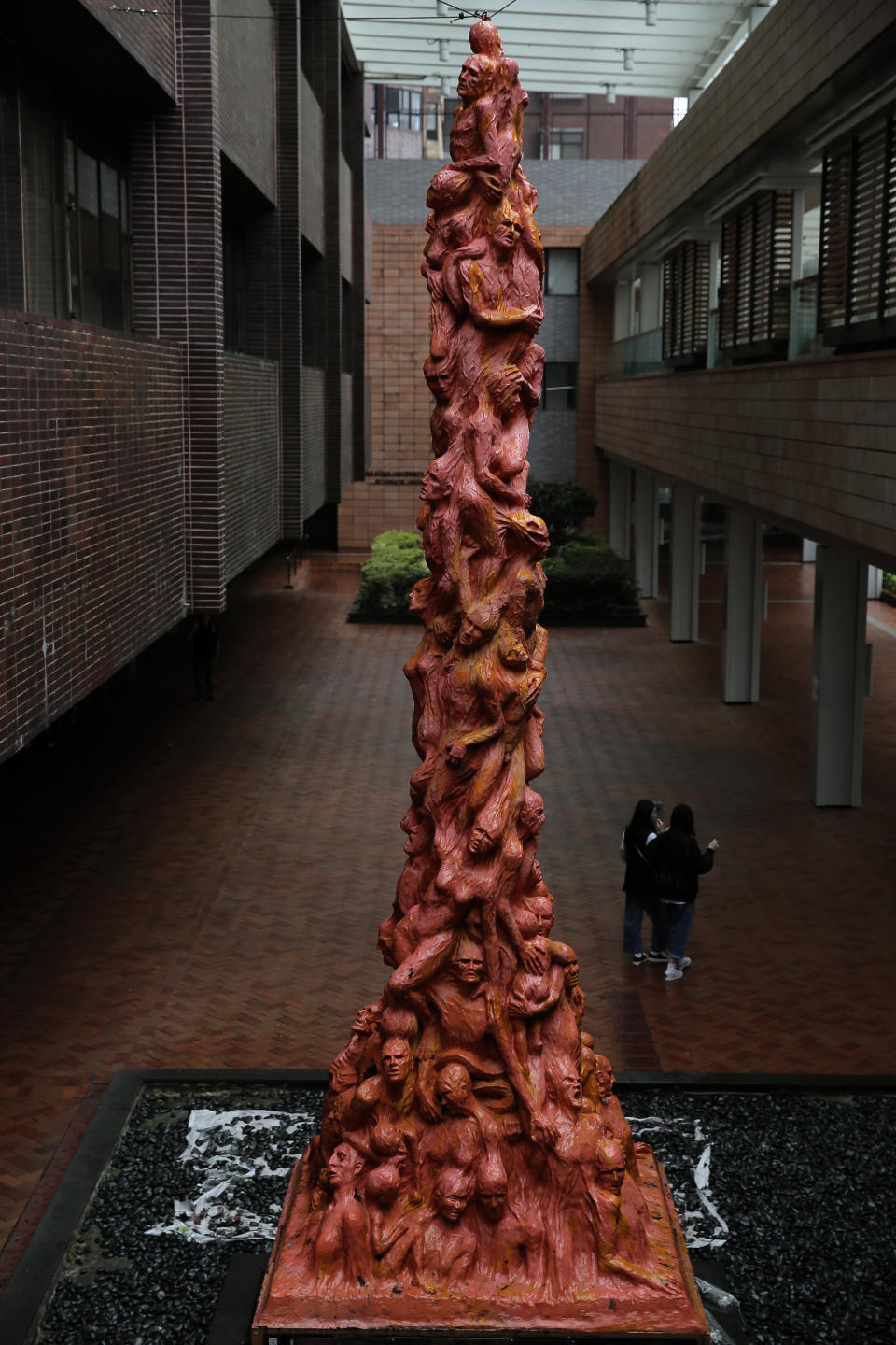 """FILE - In this May 5, 2019, file photo, the """"Pillar of Shame"""" statue, a memorial for those killed in the 1989 Tiananmen crackdown, is displayed at the University of Hong Kong. Danish artist Jens Galschioet is seeking to get back his sculpture in Hong Kong memorializing the victims of China's 1989 Tiananmen Square crackdown as a deadline loomed for its removal Wednesday, Oct. 13, 2021. (AP Photo/Vincent Yu, File)"""