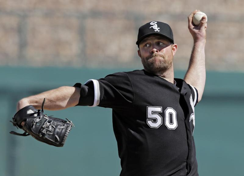 Chicago White Sox starting pitcher John Danks delivers to a Texas Rangers batter during the fifth inning of an exhibition baseball game Tuesday, March 11, 2014, in Glendale, Ariz. (AP Photo/Mark Duncan)