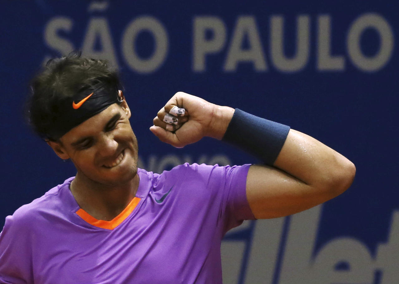 Rafael Nadal of Spain celebrates defeating David Nalbandian of Argentina in their men's singles final match to win the Brazil Open tennis tournament in Sao Paulo February 17, 2013. REUTERS/Paulo Whitaker  (BRAZIL - Tags: SPORT TENNIS TPX IMAGES OF THE DAY) - RTR3DX8F