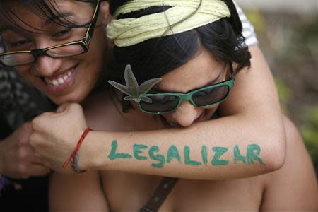 A woman embraces her friend during a rally to demand the legalization of marijuana outside the Senate building in Mexico City, in this April 20, 2012 file photo. REUTERS/Bernardo Montoya/Files