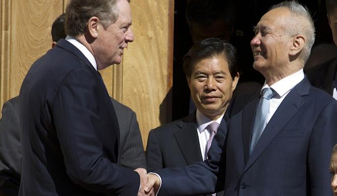 A file photo of Chinese Vice-Premier Liu He, right, shaking hands with US Trade Representative Robert Lighthizer. Photo: AP