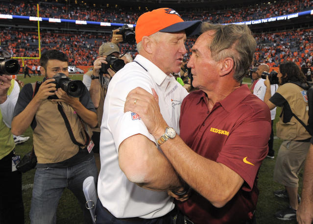 Denver Broncos coach John Fox, left, greets Washington Redskins coach Mike Shanahan after the Broncos beat the Redskins 45-21 in an NFL football game, Sunday, Oct. 27, 2013, in Denver. (AP Photo/Jack Dempsey)