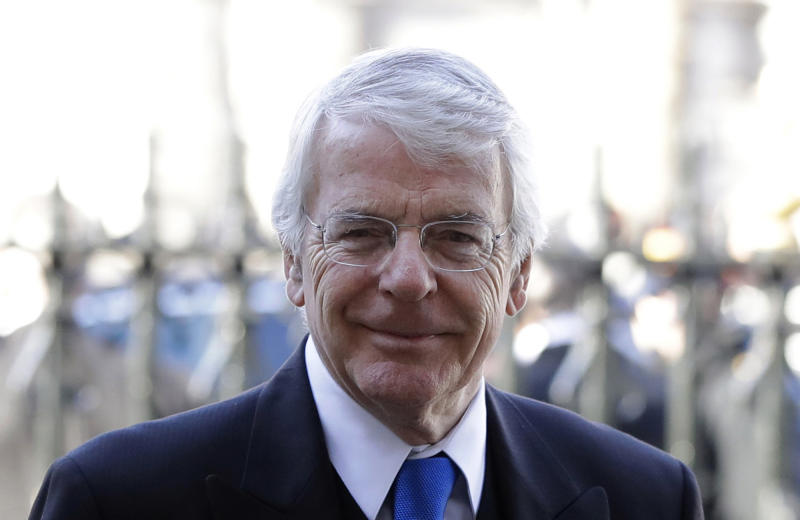FILE - In this Thursday, Jan. 31, 2019 file photo, Britain's former Prime Minister John Major arrives to attend a service of thanksgiving for the life and work of Peter Carrington at Westminster Abbey in London. Major has threatened to take Conservative Party leadership candidate Boris Johnson to court if he tries to suspend Parliament to deliver a departure from the European Union without a deal, it was reported on Wednesday, July 10, 2019. (AP Photo/Kirsty Wigglesworth, File)